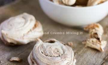 Homemade meringues with brown chocolate stripes and milk