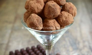 Homemade chocolate truffles in a glass on a rustic background.