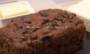 A slate plate of Welsh traditional fruit bread (Bara Brith) with cheese and butter ** Note: Slight blurriness, best at smaller sizes